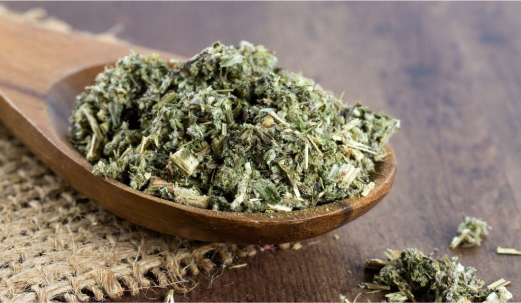 a spoonful of mugwort leaves used in yuan herbal handmade classic soap